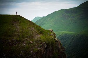 Yoga in the dark sombre mountains. - Tartalja
