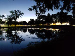 Sunset reflexes the night lights