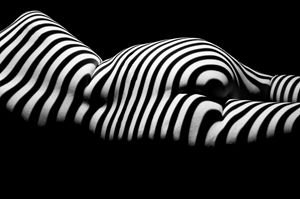 Striped laying nude from behind