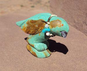 Turquoise hawk with amethyst gem