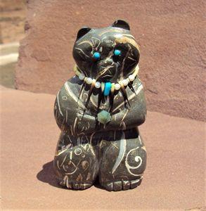 Standing shell stone bear.