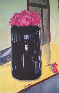 Pink flowers in a black vase
