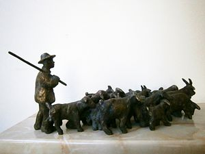 Shepherd with a flock of goats