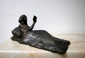 Lying girl with book