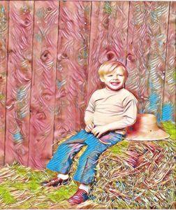 cute boy on hay