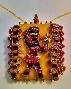 Indian girl and mirror pendant