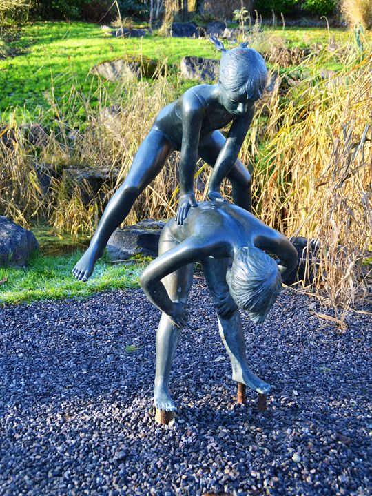 Statue of two children playing - Helen A. Lisher