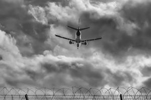 Through the airport fence