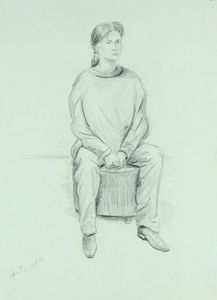 Seated woman on round stool