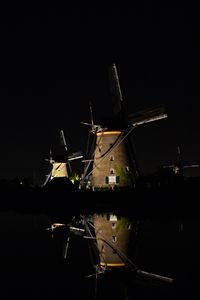 Windmills at night in water