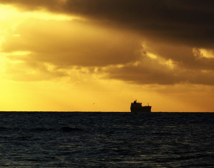 A ship sets sail under a golden skys - Robert Brown Photography