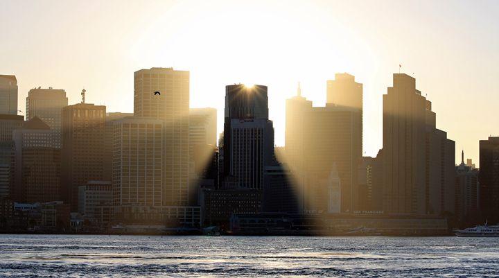 Sun Behind Building - Photography by Armando