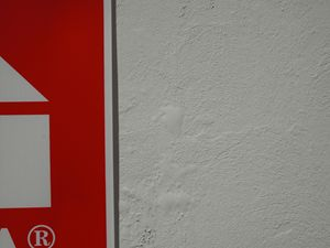 Red sign on white wall