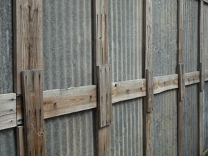 Wood and metal fence