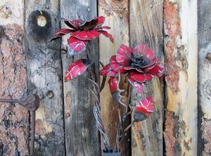 red metal flower - ruff cut wood and metal