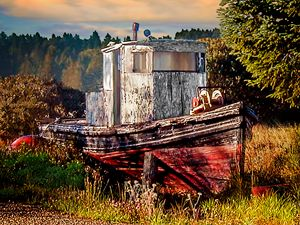 Abandoned Boat in Field at Sunrise