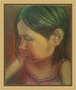 Portrait of a little girl painting