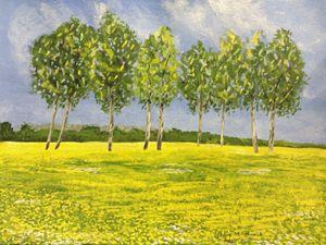 Trees in the dandelion field