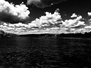 Black lake, white clouds
