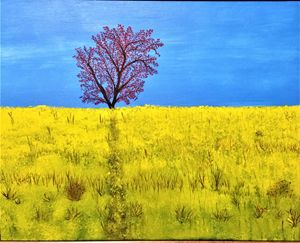 Tree in yeloow flowers field